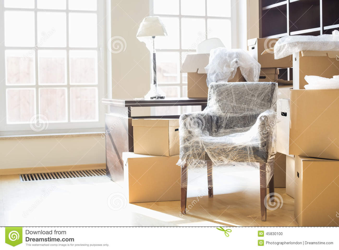 moving boxes and furniture in new home stock photo image 45830100. Black Bedroom Furniture Sets. Home Design Ideas