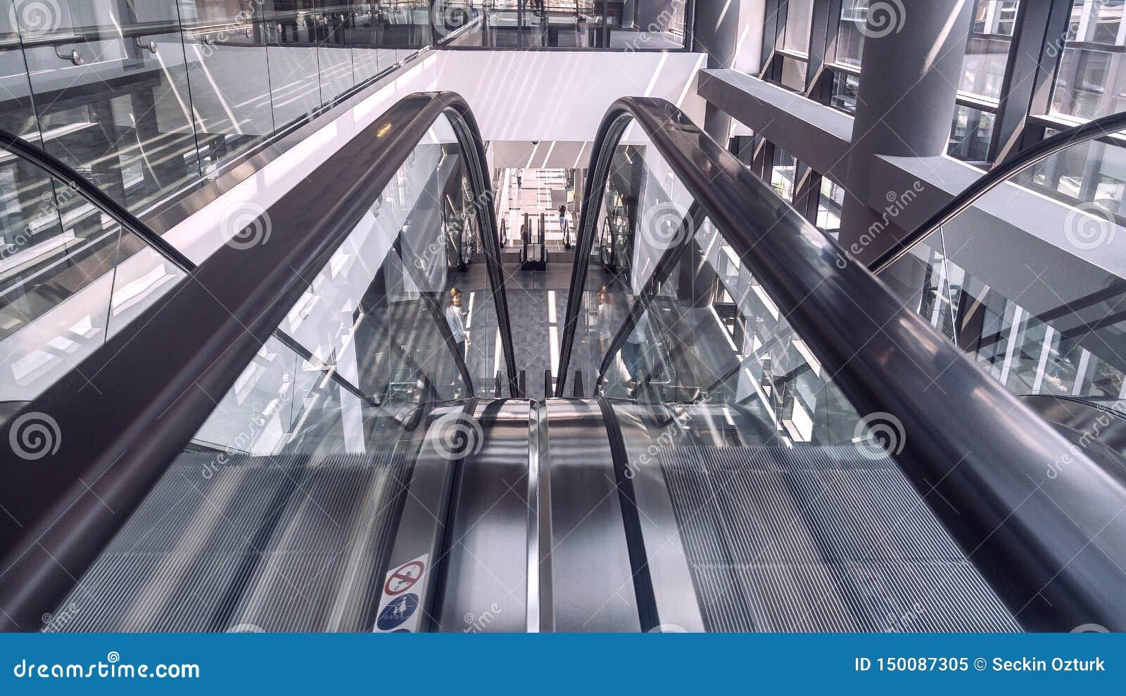 Moving escalator in interior of office building