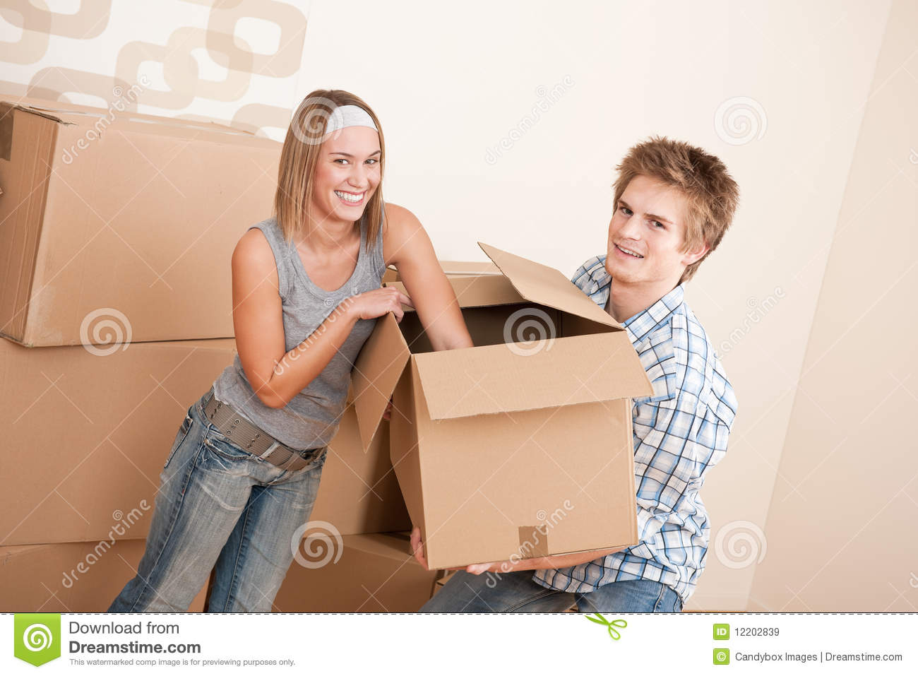 Moving house young couple moving box unpacking royalty free stock images image 12202839 - Young couple modern homes ...