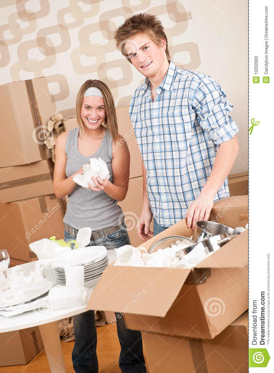 Moving house young couple unpacking dishes stock photos image 12202893 - Young couple modern homes ...
