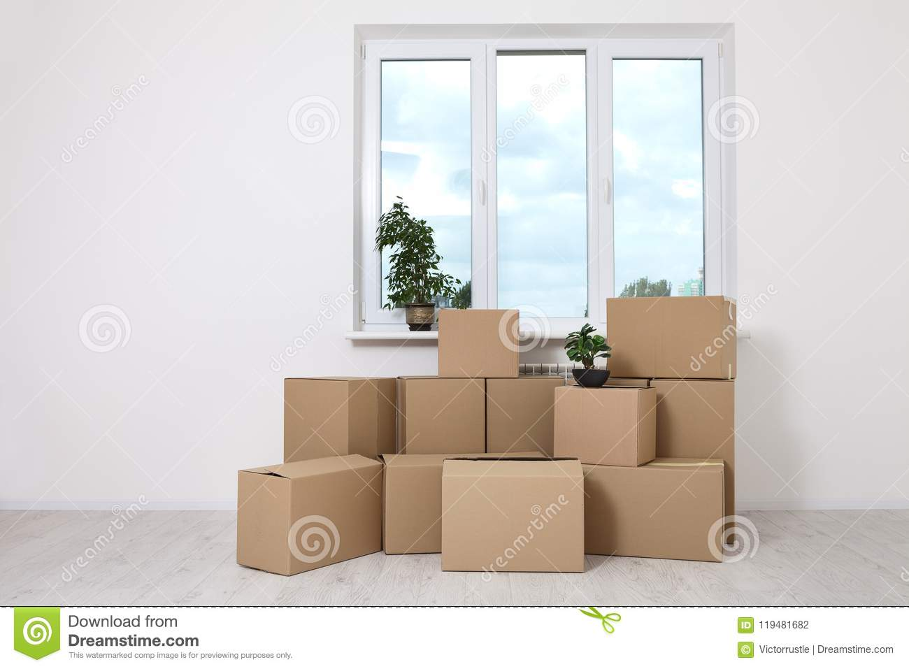 moving into a new apartment move lots of cardboard boxes in an empty new apartment stock photo. Black Bedroom Furniture Sets. Home Design Ideas