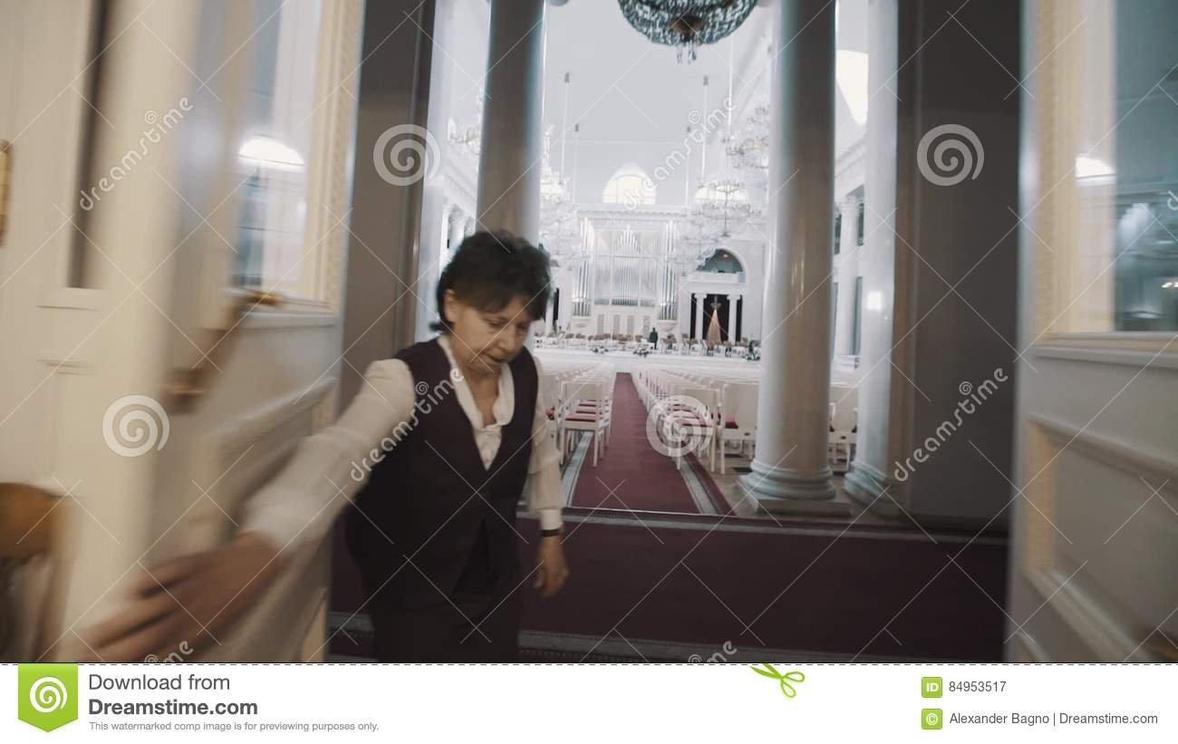 Moving Shot Old Woman Open Doors In To Empty Bright Organ Hall With Lot Of Seats Stock Video - Video of entertainment applaud 84953517 & Moving Shot Old Woman Open Doors In To Empty Bright Organ Hall With ...