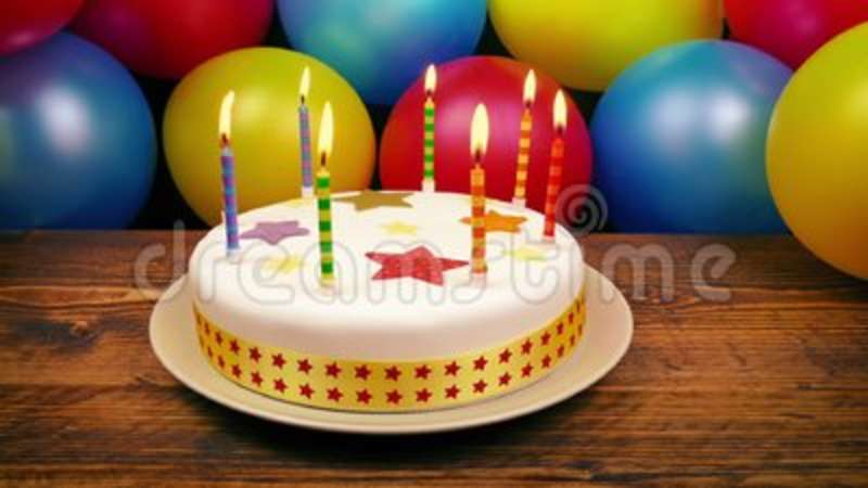 Birthday Cake With Lit Candles On Table Stock Video