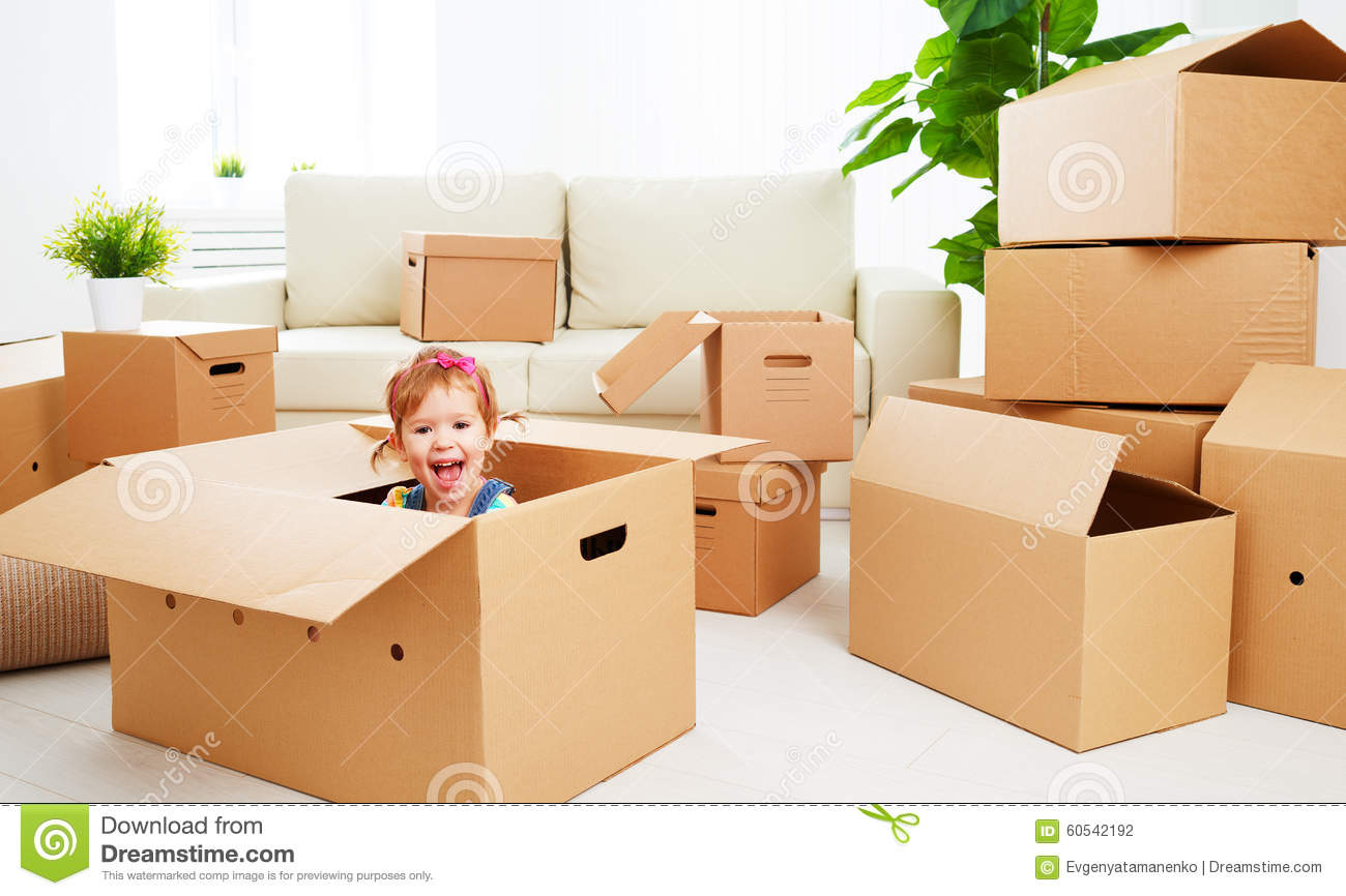 moving to new apartment happy child in cardboard box stock photo image 60542192. Black Bedroom Furniture Sets. Home Design Ideas