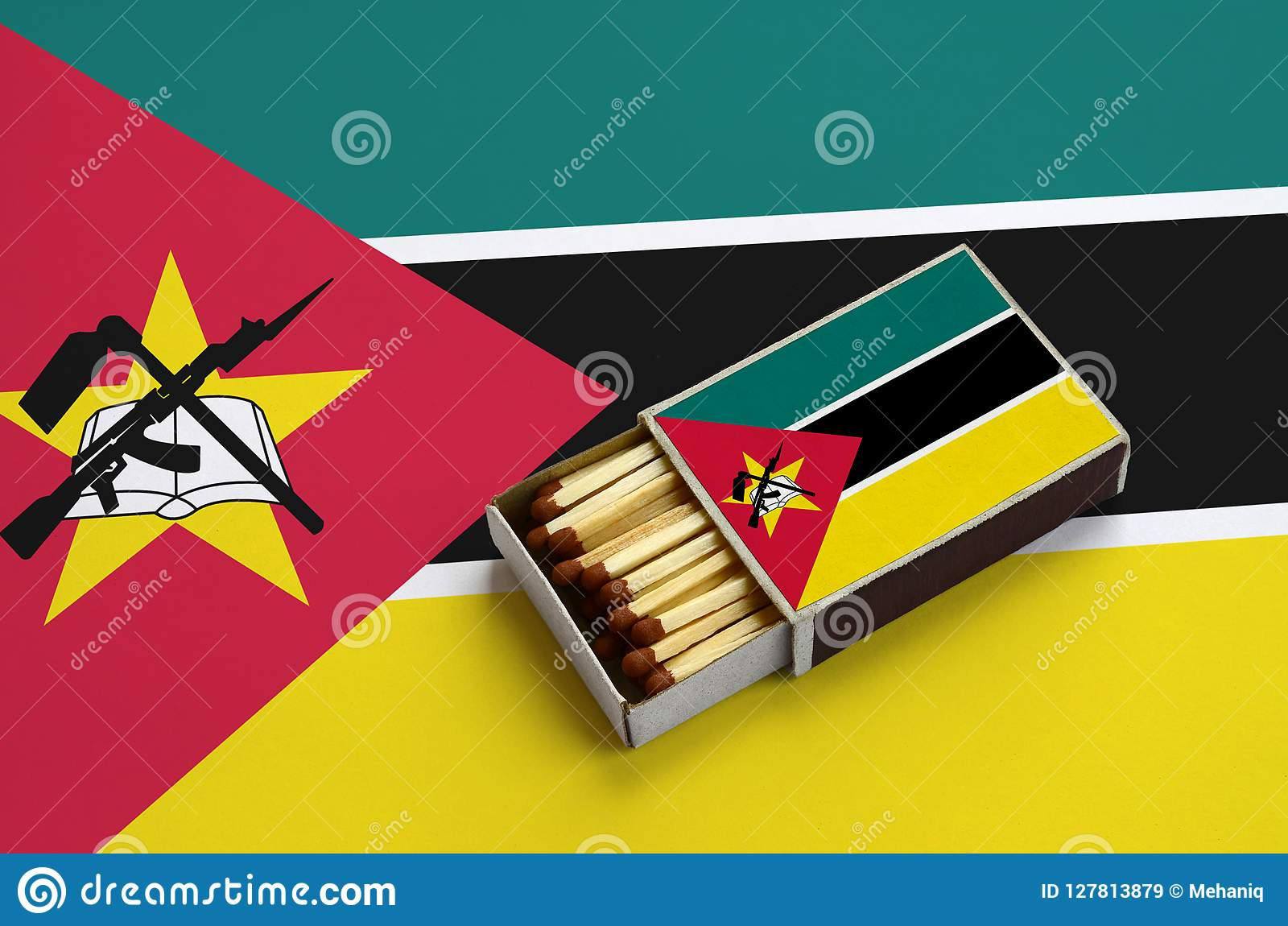 Mozambique Flag Is Shown In An Open Matchbox, Which Is