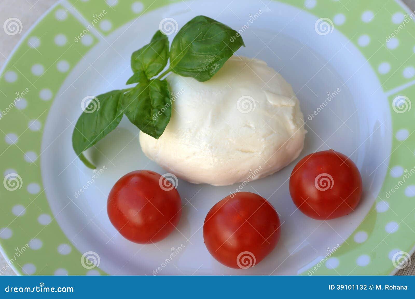 Mozarella met tomaten en basilicum