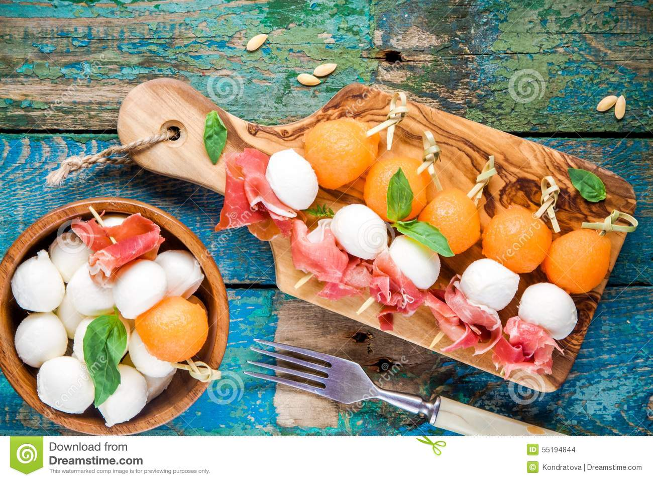 Mozzarella and prosciutto with melon canapes with basil on for Prosciutto and melon canape