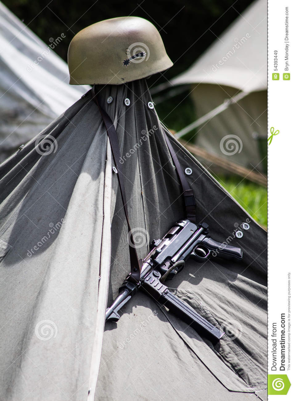 MP 40 and Helmet Hanging on a Tent