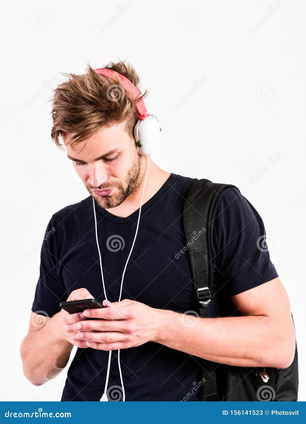 Mp3 player concept. Enjoy perfect music sound headphones. Music gadget. Musical accessory gadgets. Man listen music