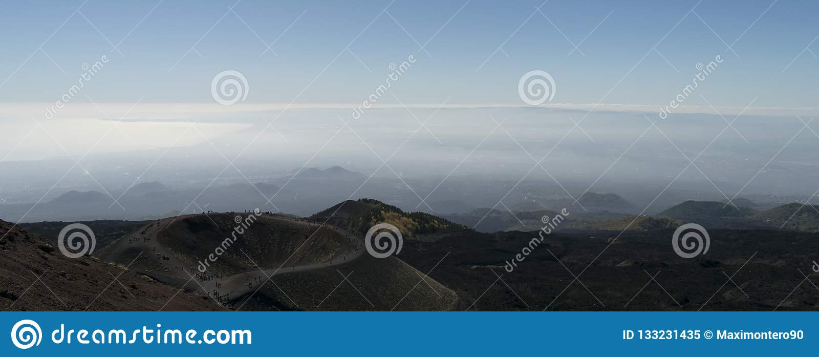 Mt Etna Panorama showing a crater and with clouds in the background