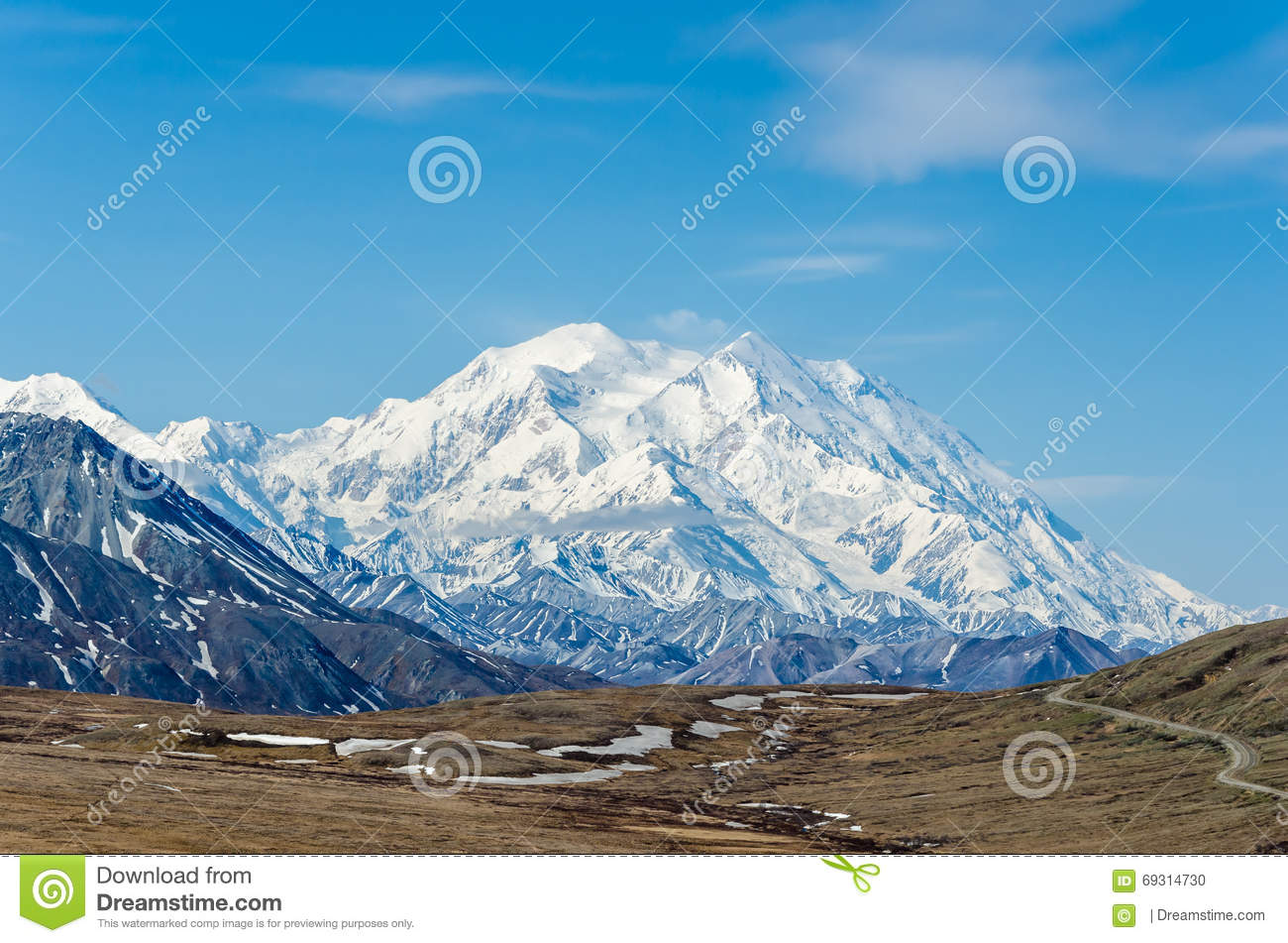 Mt McKinley - highest mountain in North America on a sunny day with blue sky