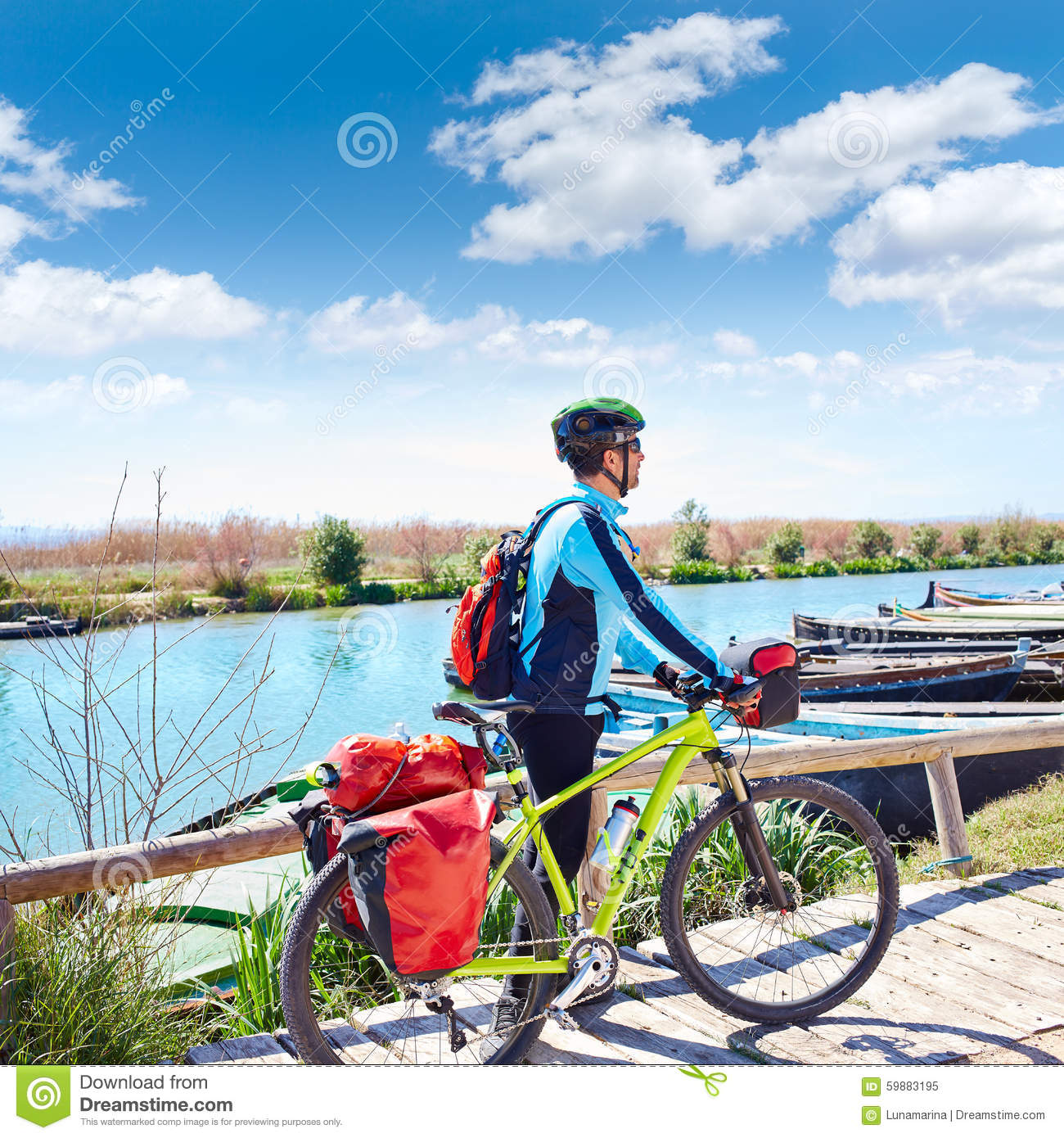 MTB Biker Bicycle touring on the river with pannier