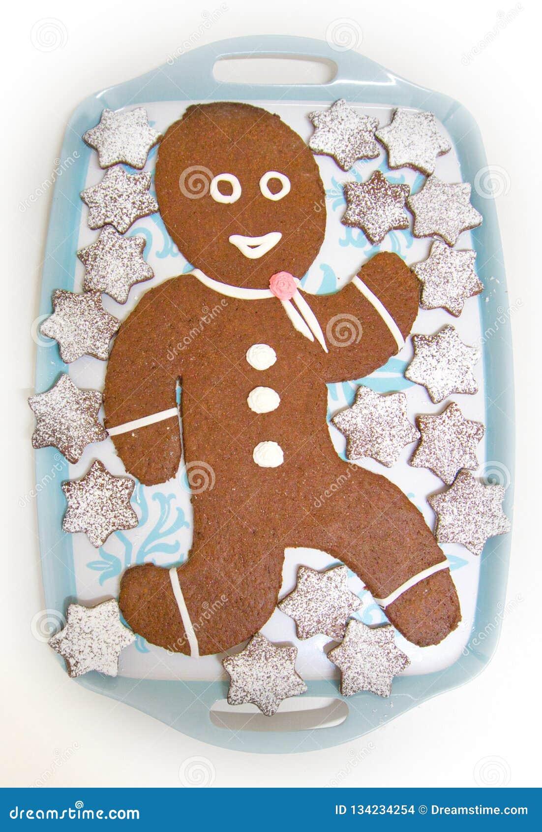 Muñeca del pan de jengibre con el chocolate y las estrellas