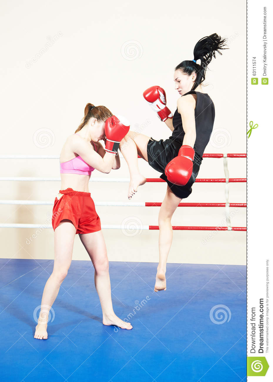 Muay Thai Woman Fighting At Boxing Ring Stock Photo ...