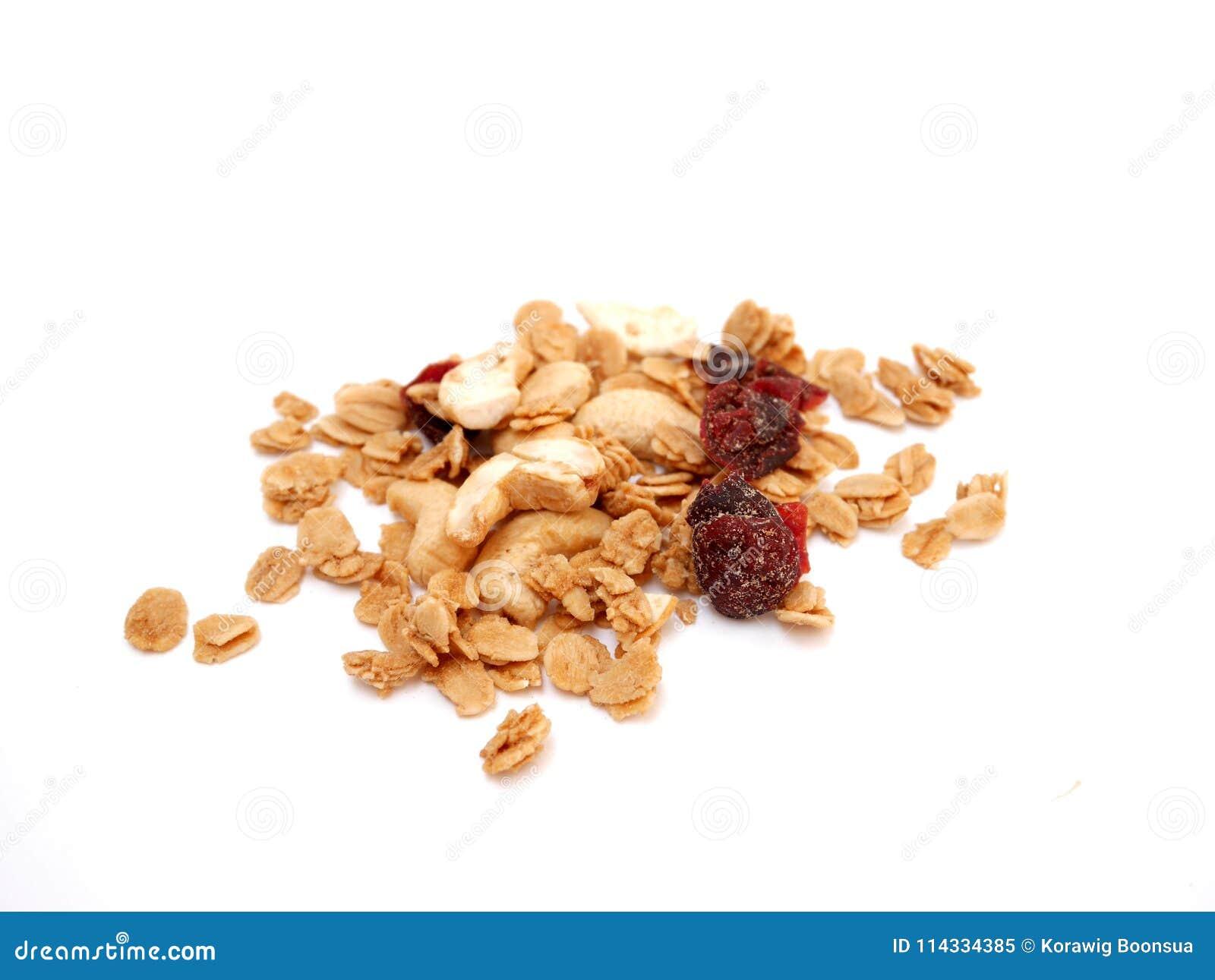 Mucchio del cereale del granola sull isolato su