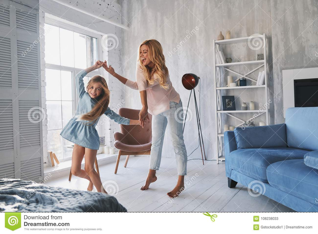 So much fun! Full length of mother and daughter holding hands an