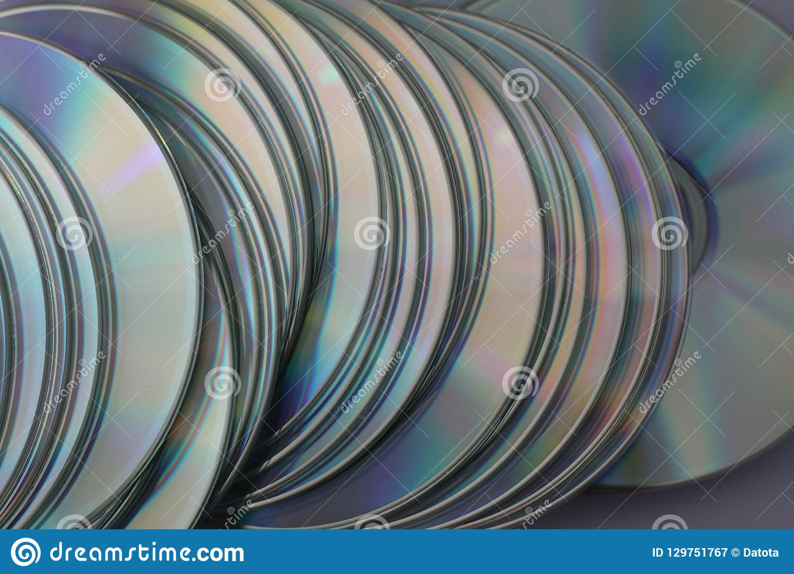 Much silver compact discs scattered on flatness