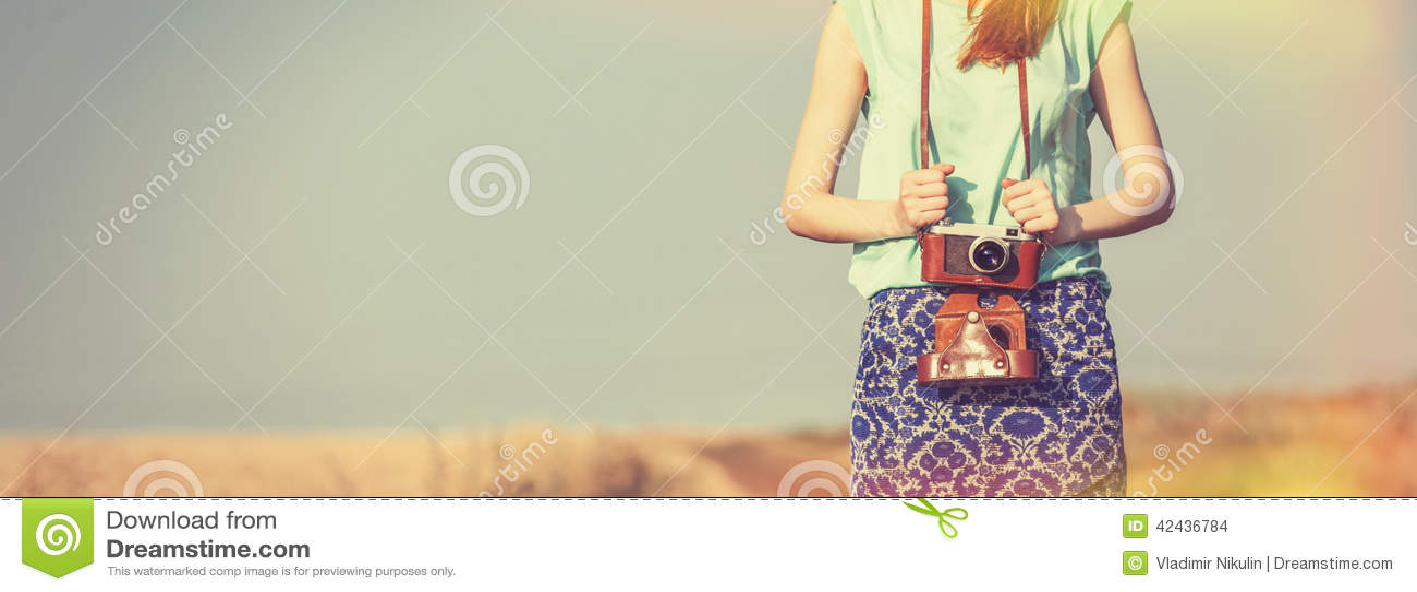 Muchacha con la cámara