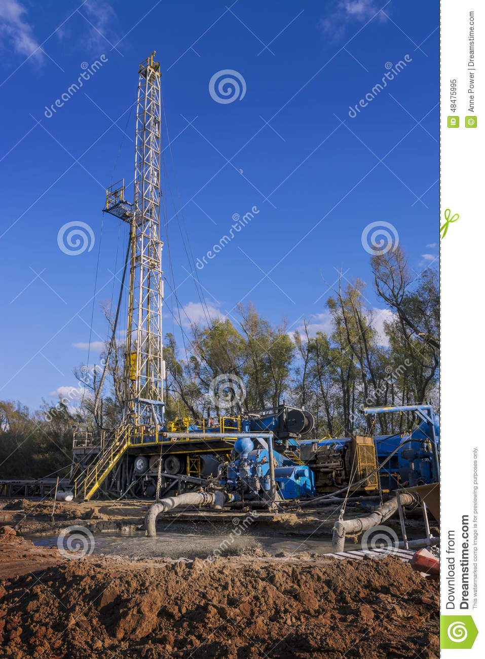 Mud Pumps In Front Of Oil Drilling Rig Stock Image - Image