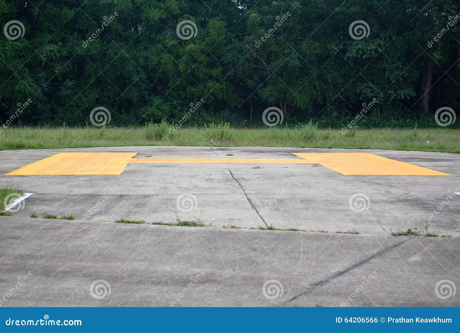 Muestra amarilla en helipuerto concreto