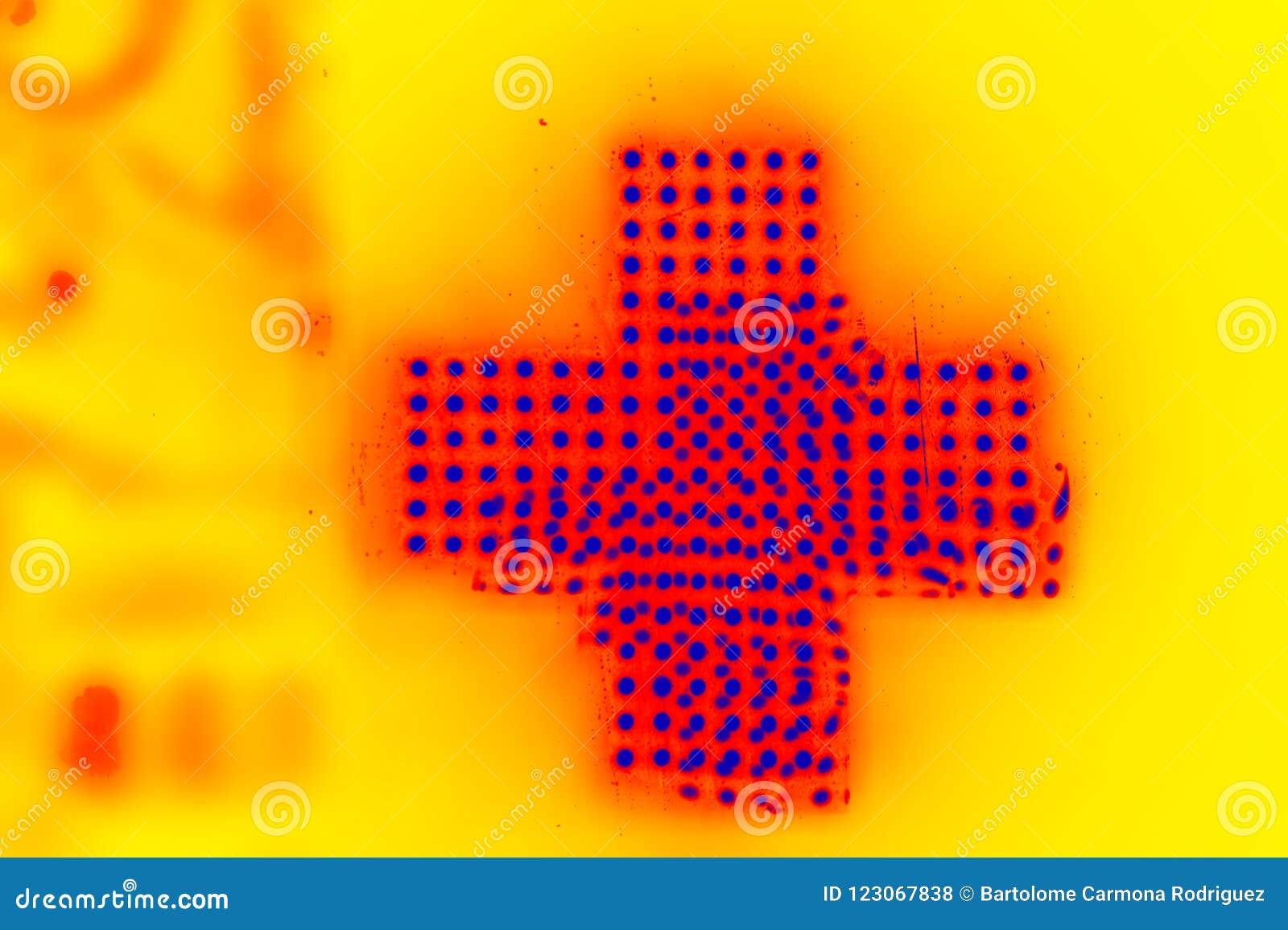 Muestra de la cruz de mucha luz de amarillo y azul de neón