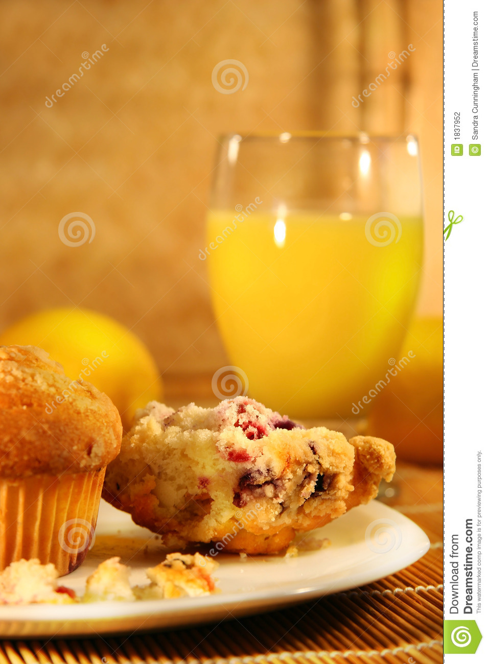 Healthy breakfast with cranberry muffins and orange juice on bamboo ...