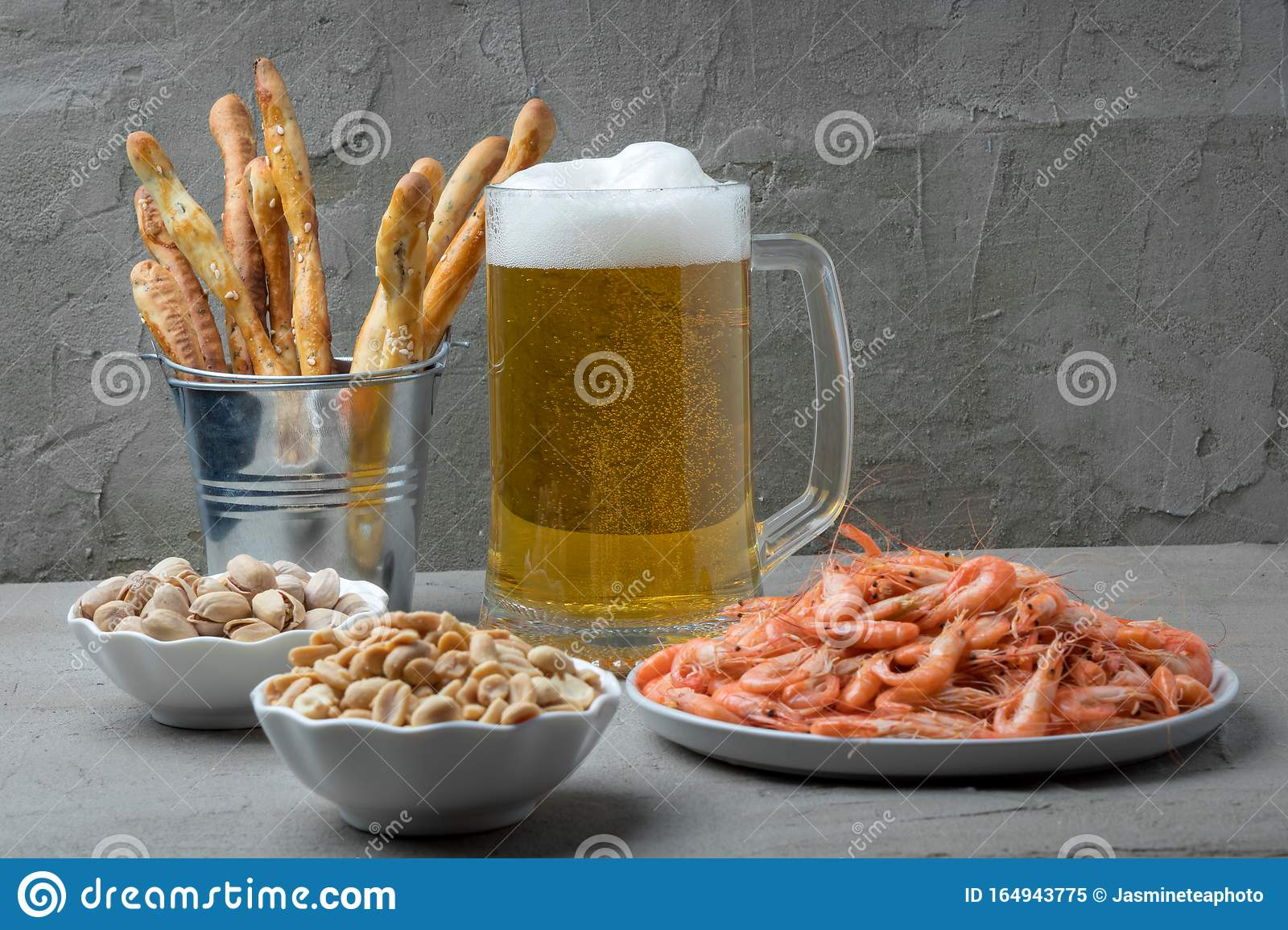 Mug Of Fresh Beer And Tasty Snacks On Grey Table Stock Image Image Of Alcohol Drink 164943775