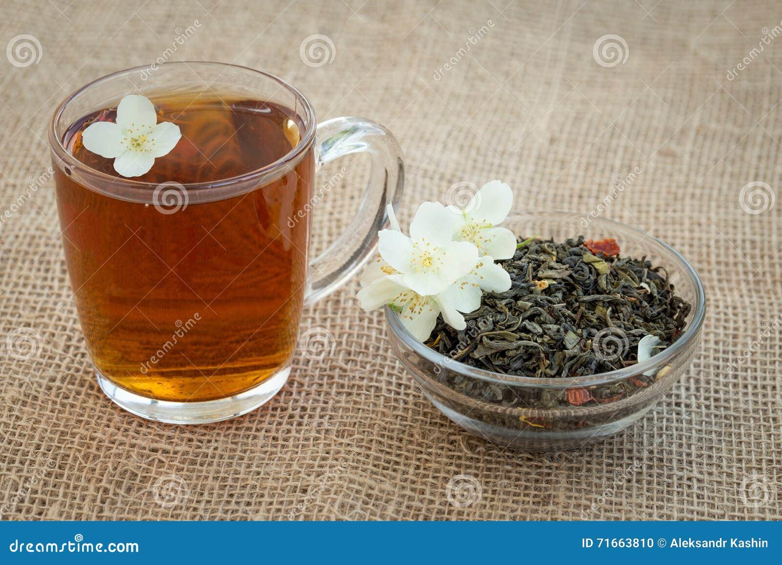 Mug Of Tea And Dried Green Tea With Jasmine Flowers Stock Photo