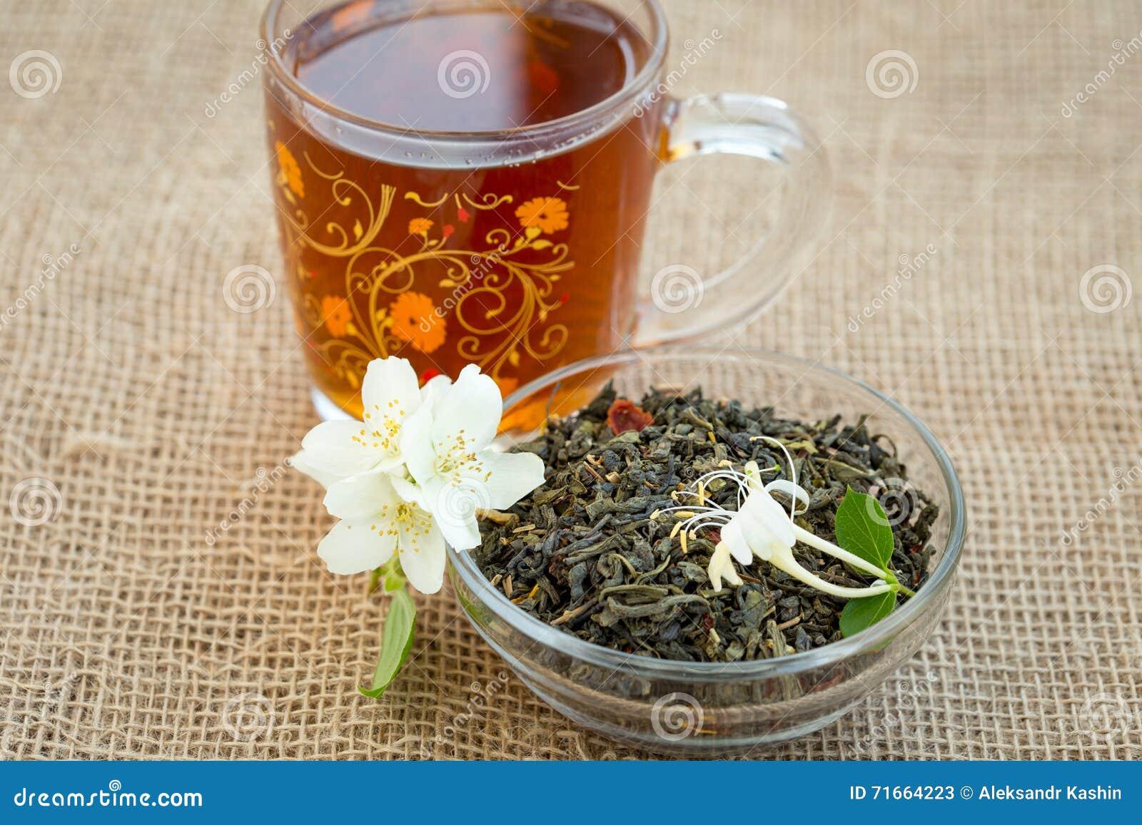 Mug Of Tea And Dried Green Tea With Jasmine Flowers Stock Image