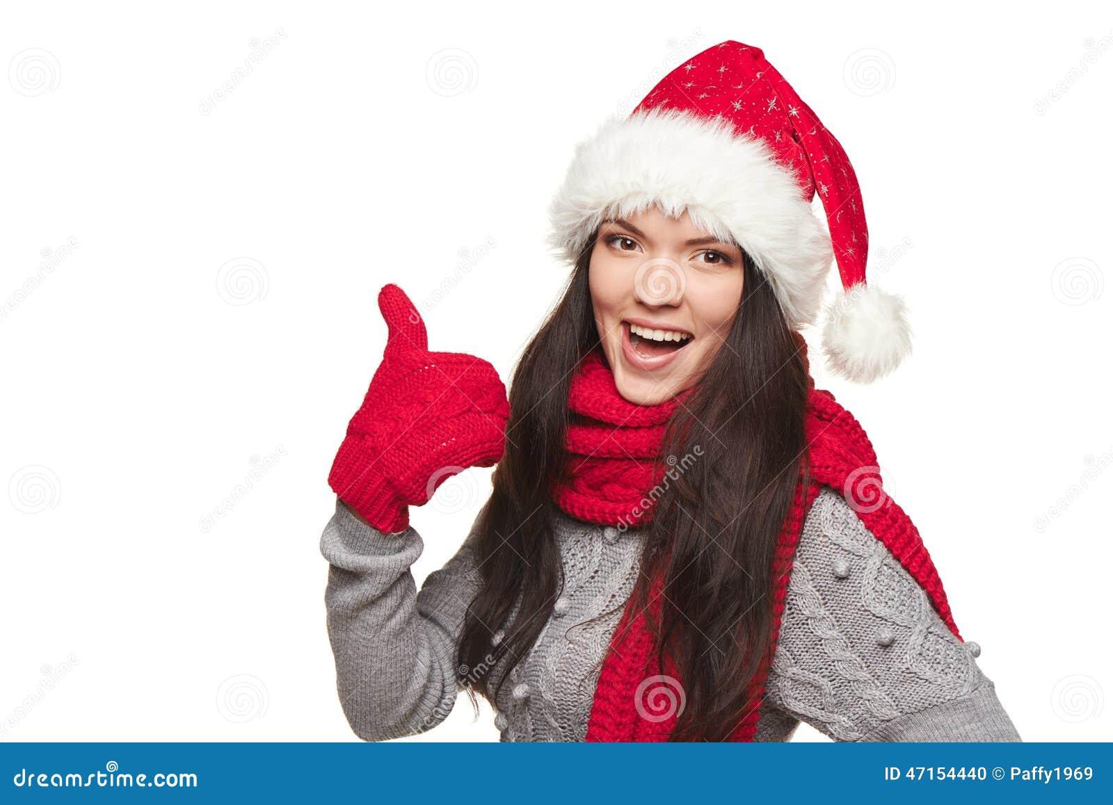 Mujer de Navidad que muestra el pulgar para arriba