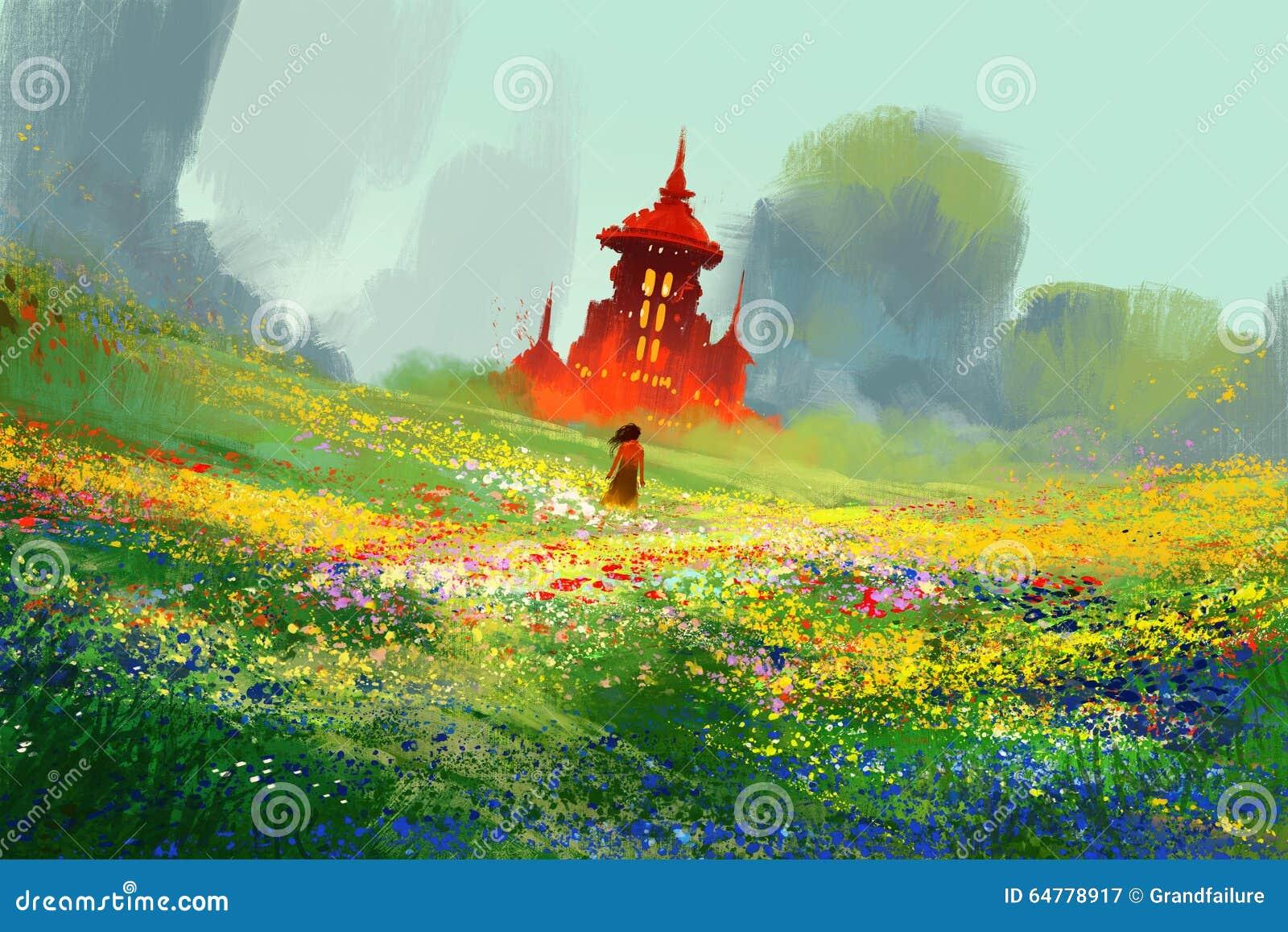 Mujer en campos de flor al lado del castillo y de la montaña rojos