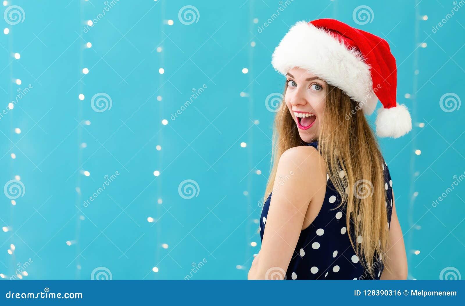 Mujer Feliz Con Un Sombrero De Papá Noel Foto de archivo - Imagen de ... c5b45973577