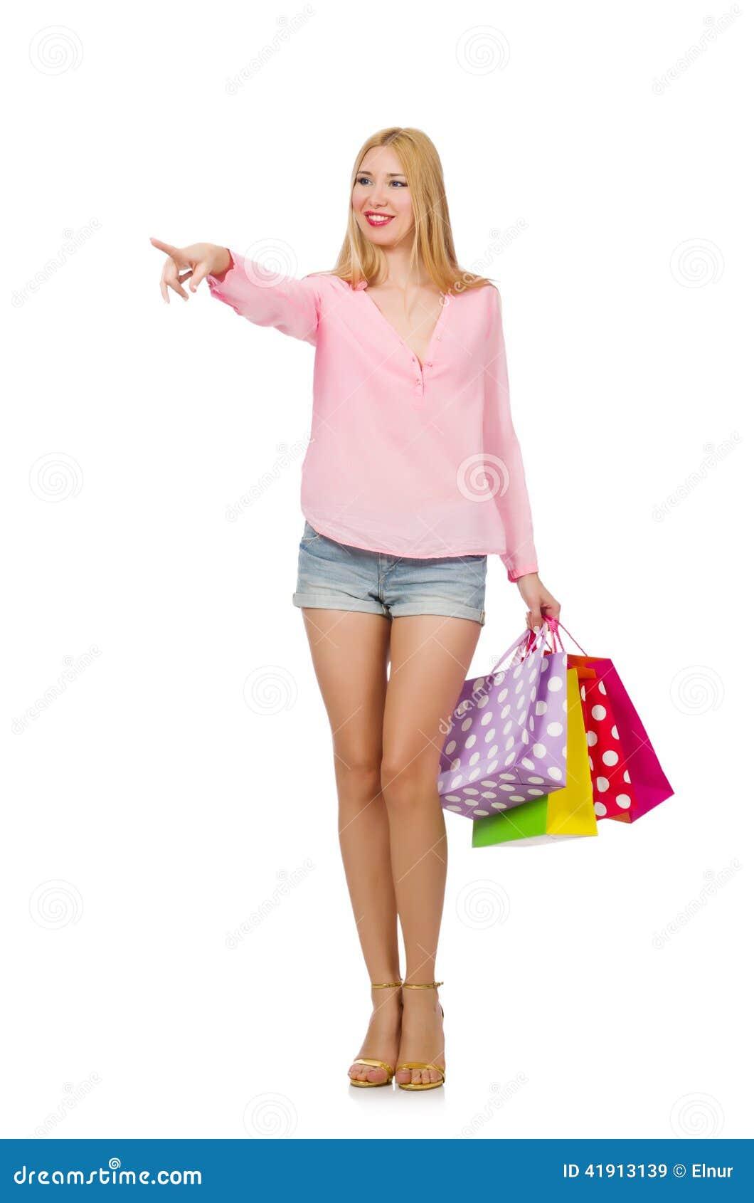 Mujer joven con los bolsos de compras