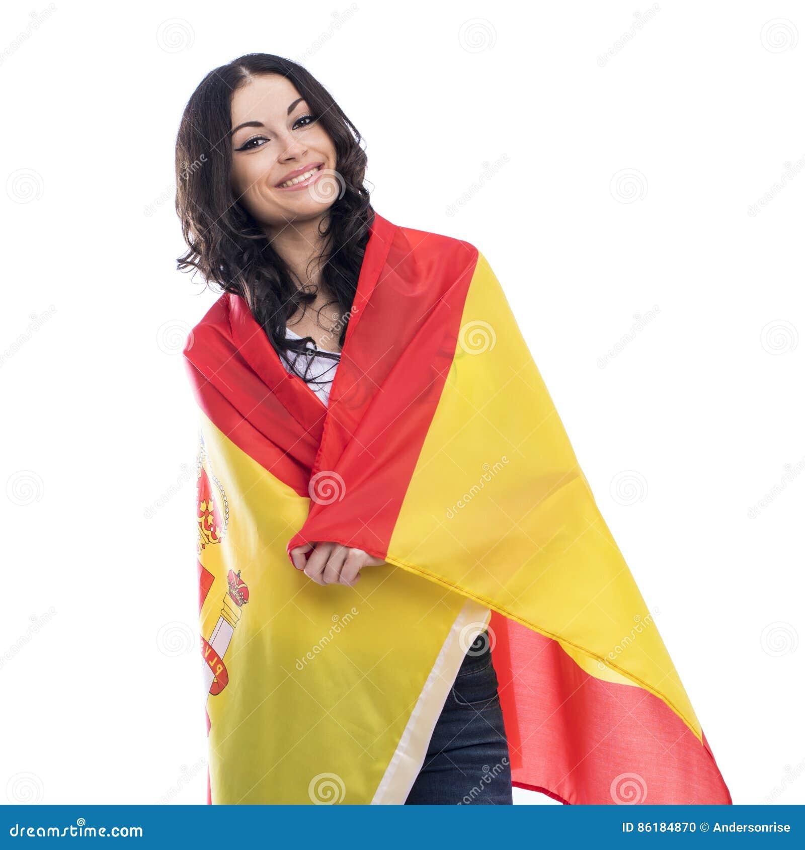 Mujer joven en el fondo de la bandera española