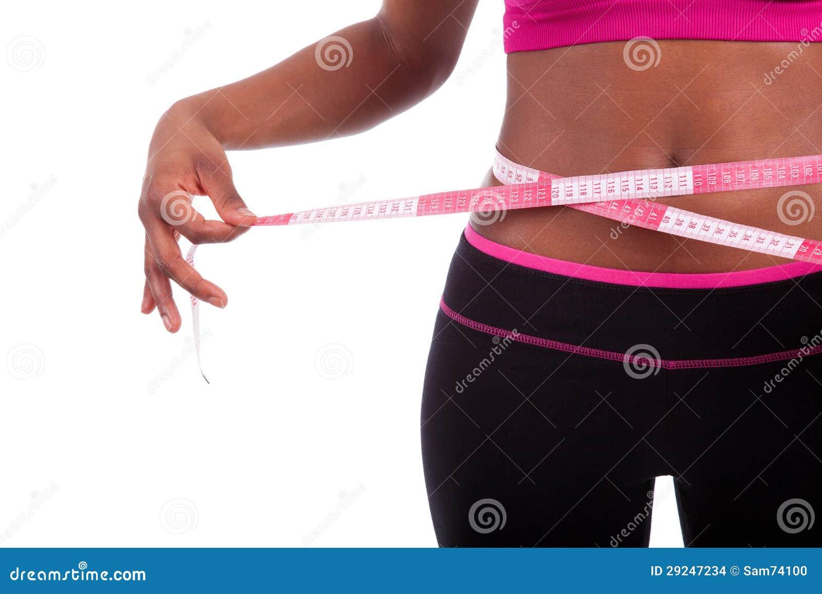 Download Mulher Americana Africana Da Aptidão Que Mede Sua Barriga Foto de Stock - Imagem de cuidado, povos: 29247234