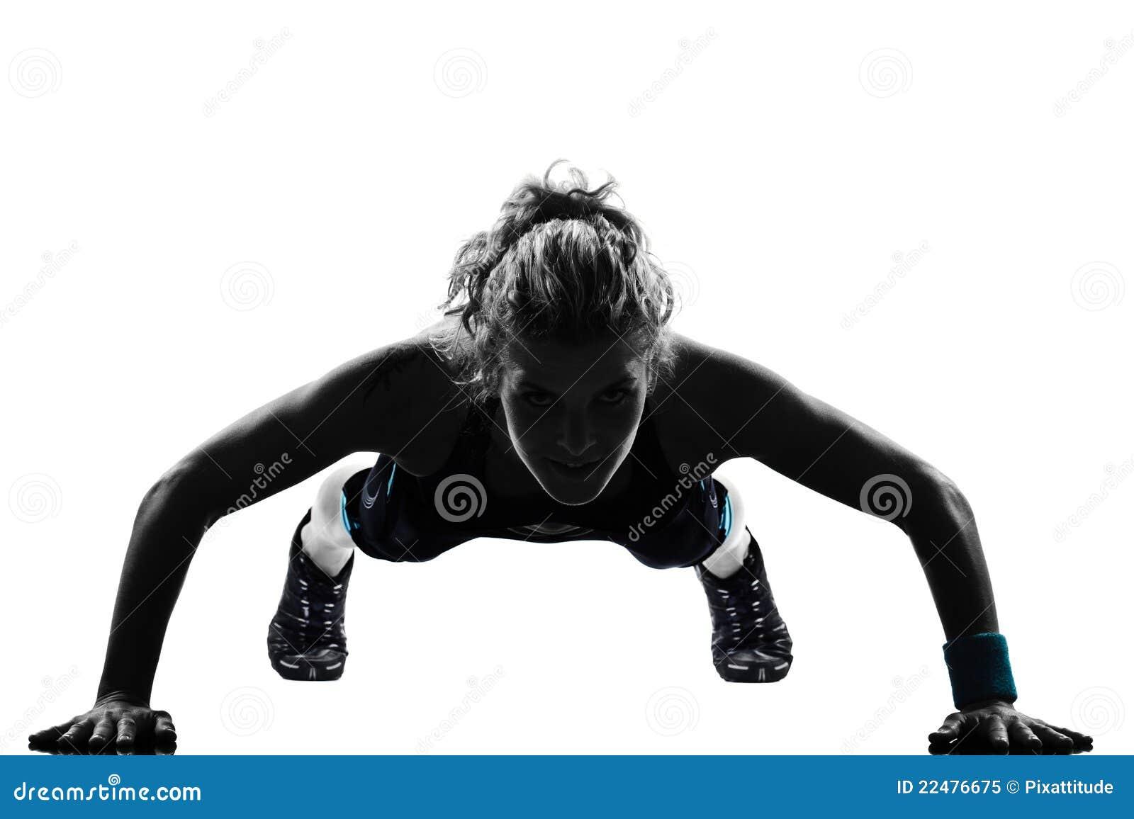 A mulher a aptidão do exercício que empurra levanta a postura