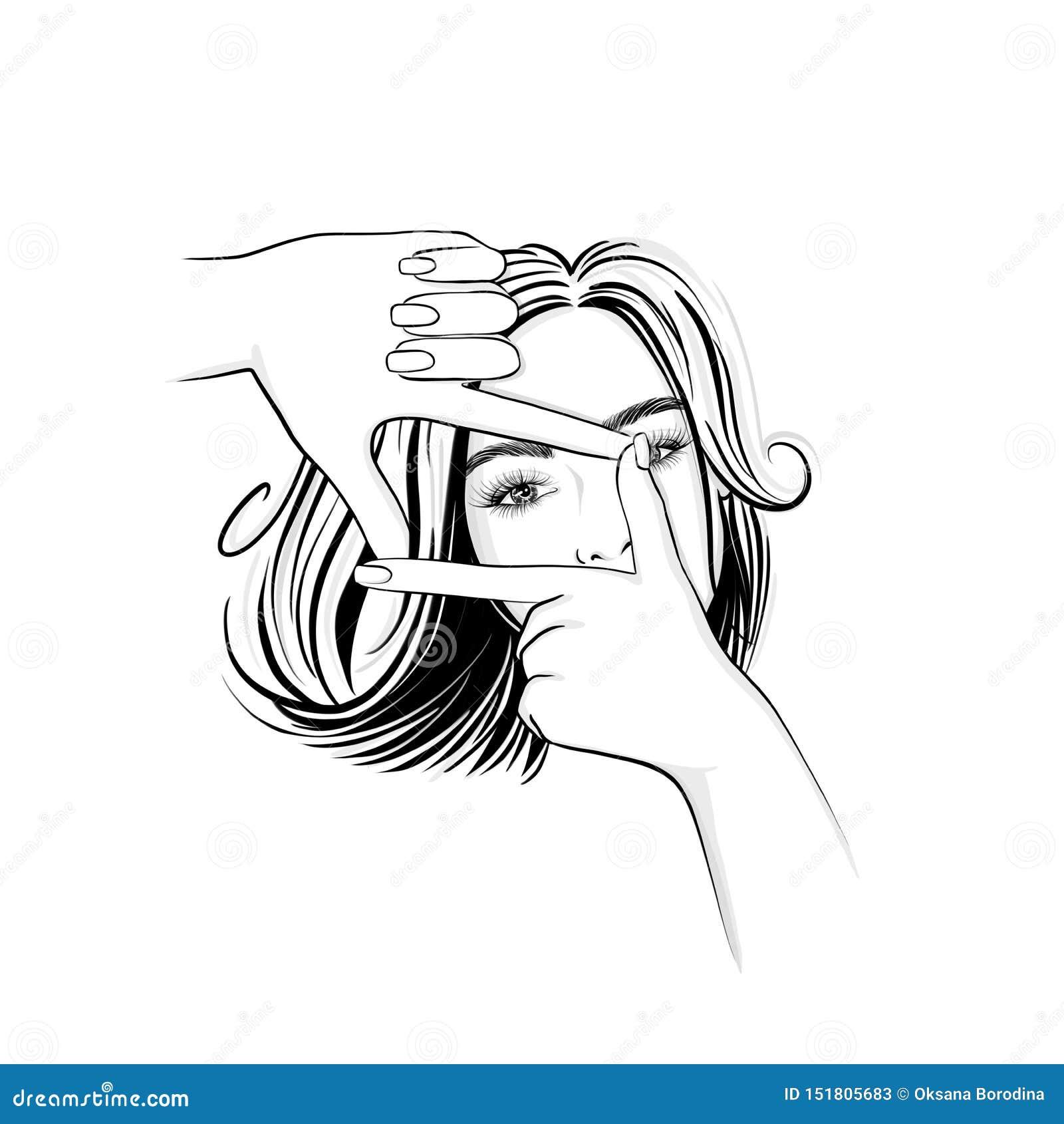 Mulher bonita com o cabelo médio do comprimento que olha através de um quadro da mão