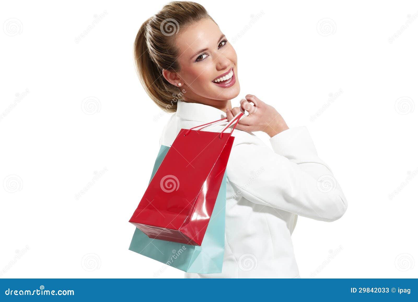 Mulher bonita nova com saco de compras