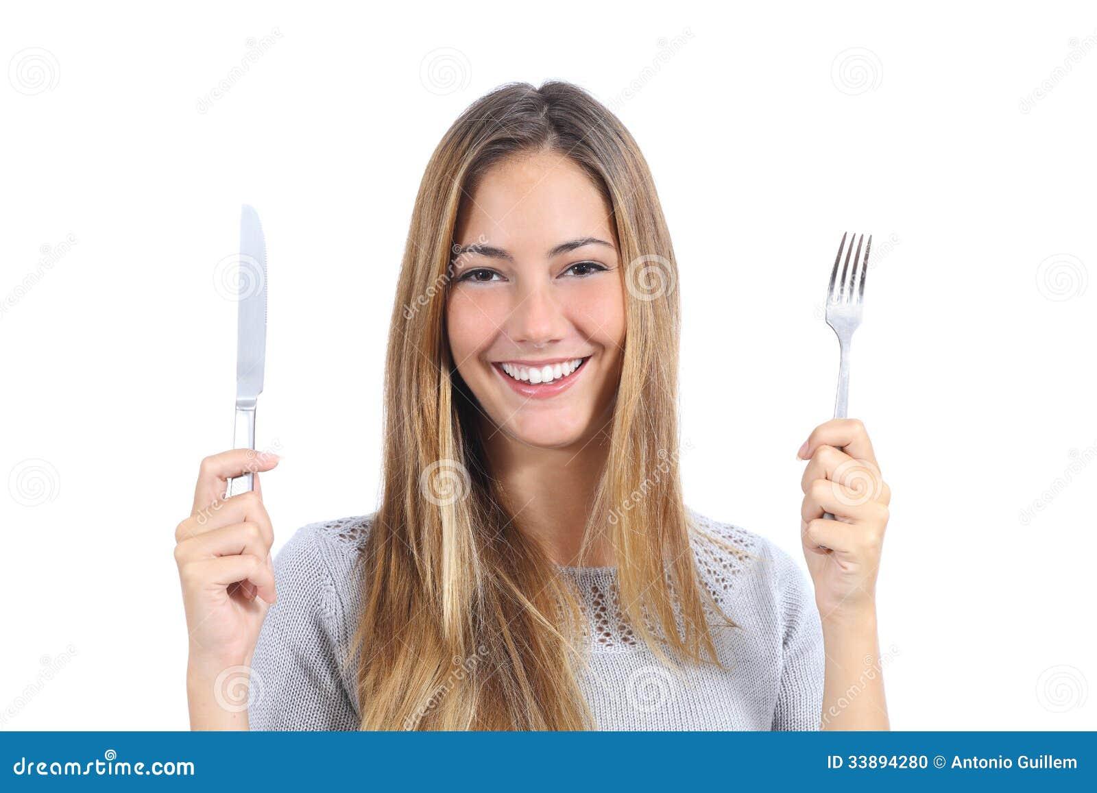 mulher-bonita-que-guarda-uma-forquilha-e-uma-faca-de-tabela-33894280.jpg