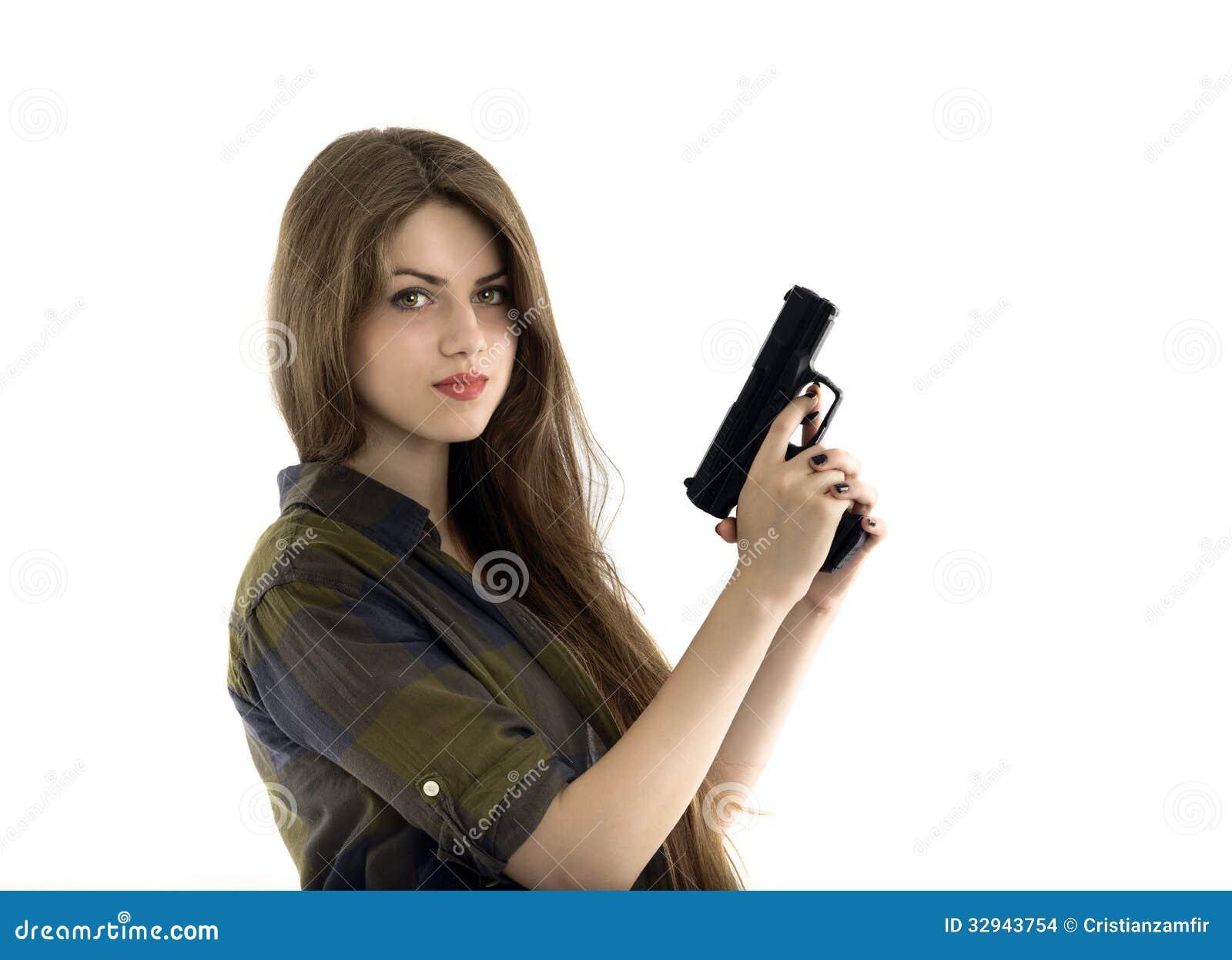 mulher-bonita-que-guardara-uma-arma-no-fundo-branco-32943754.jpg