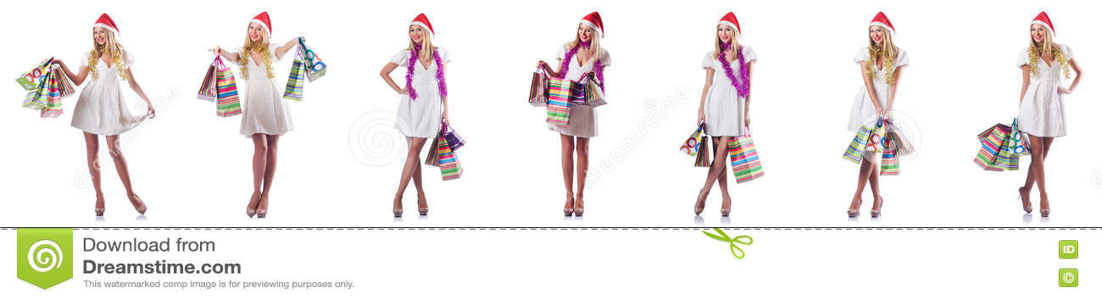 A mulher com os sacos de compras isolados no branco