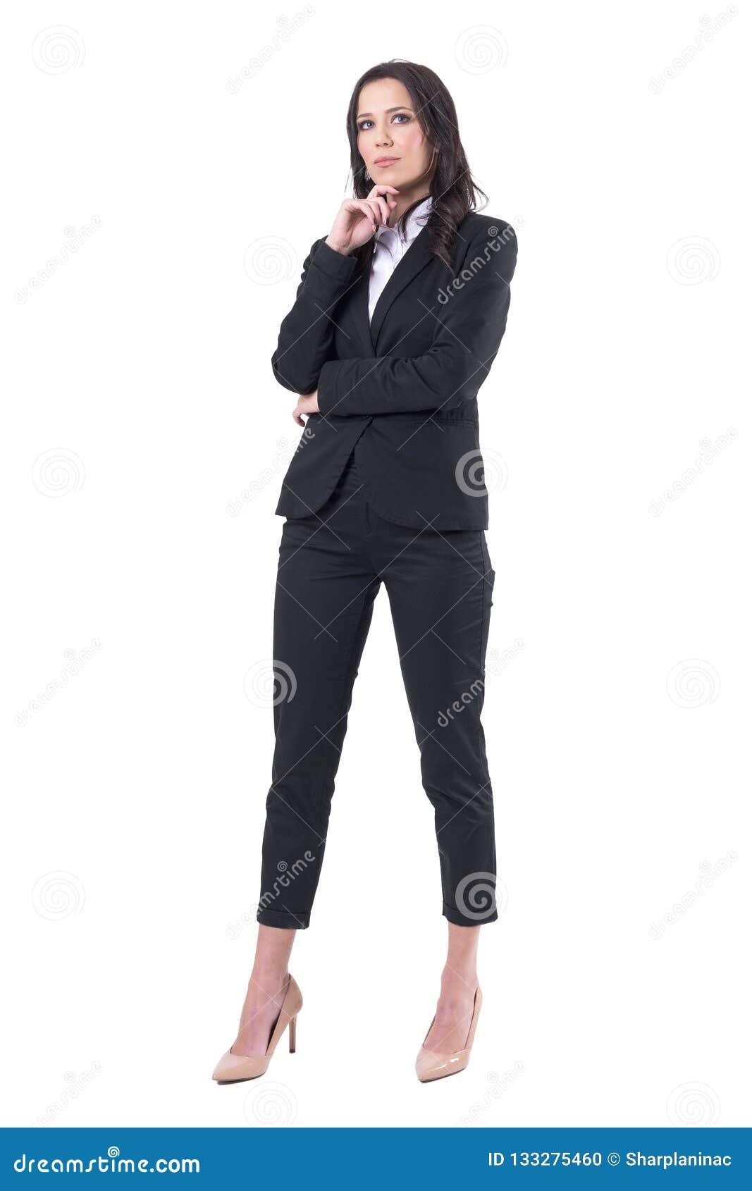 Mulher de negócio bem sucedida pensativa que olha acima tendo a ideia