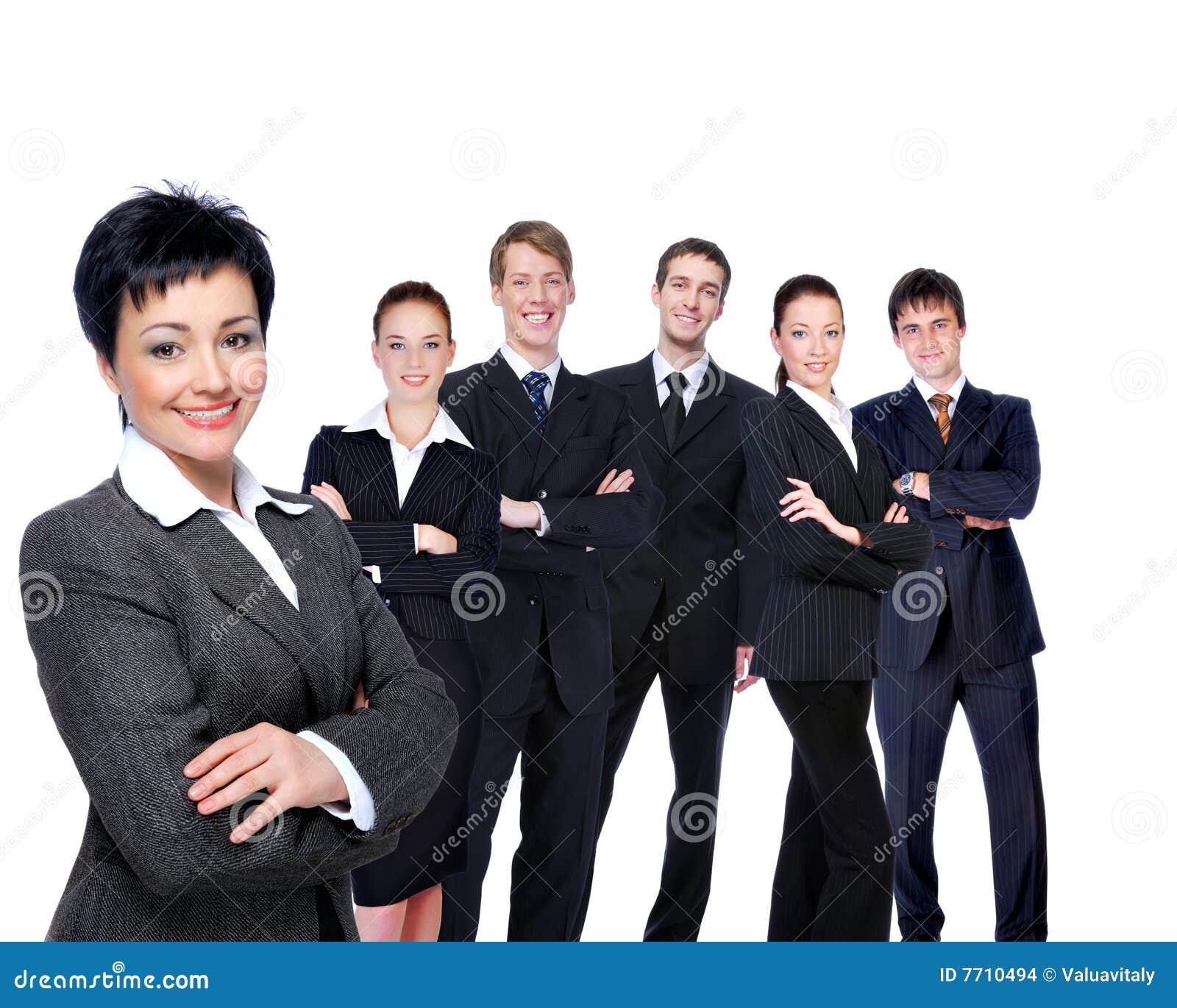 Mulher de negócios bem sucedida com grupo de trabalho.
