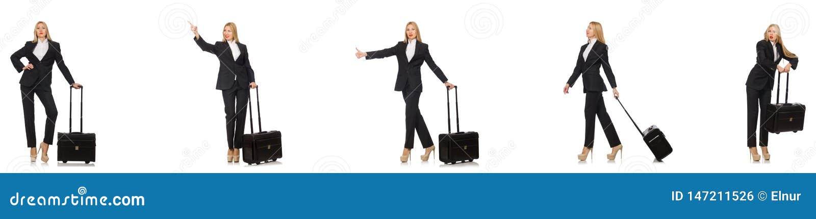 A mulher de neg?cios com a mala de viagem isolada no branco