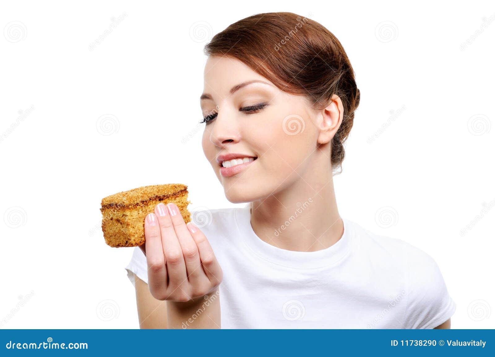 Mulher que come o bolo