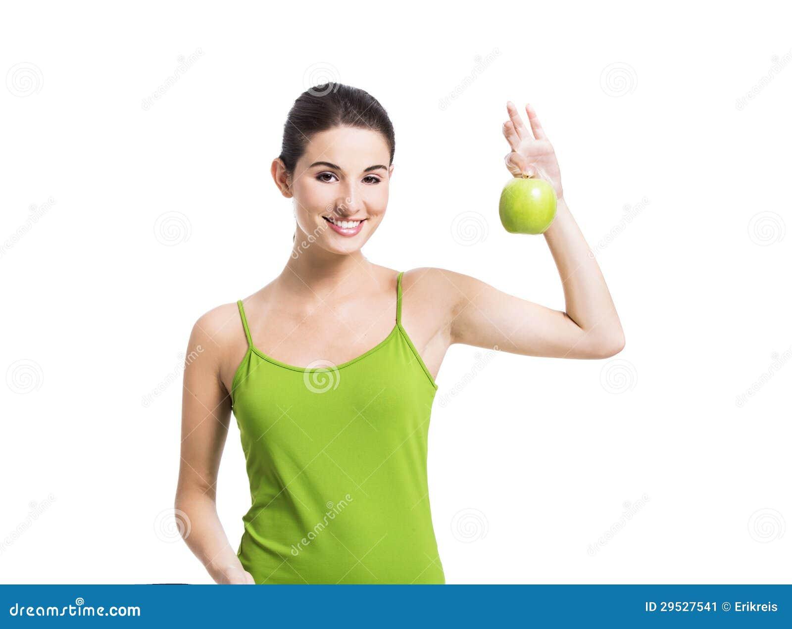 Mulher saudável com uma maçã verde