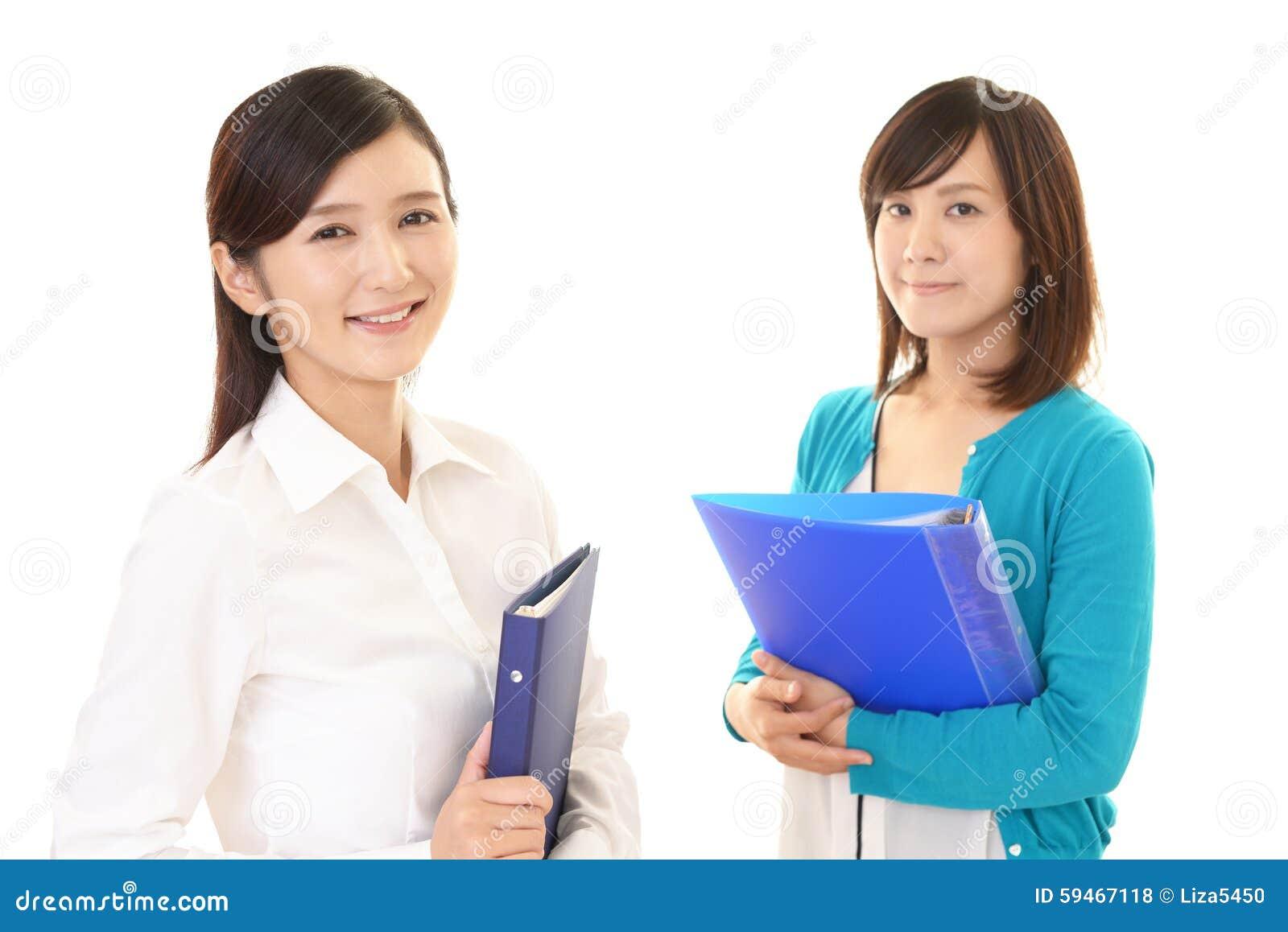 Mulheres de negócio de sorriso