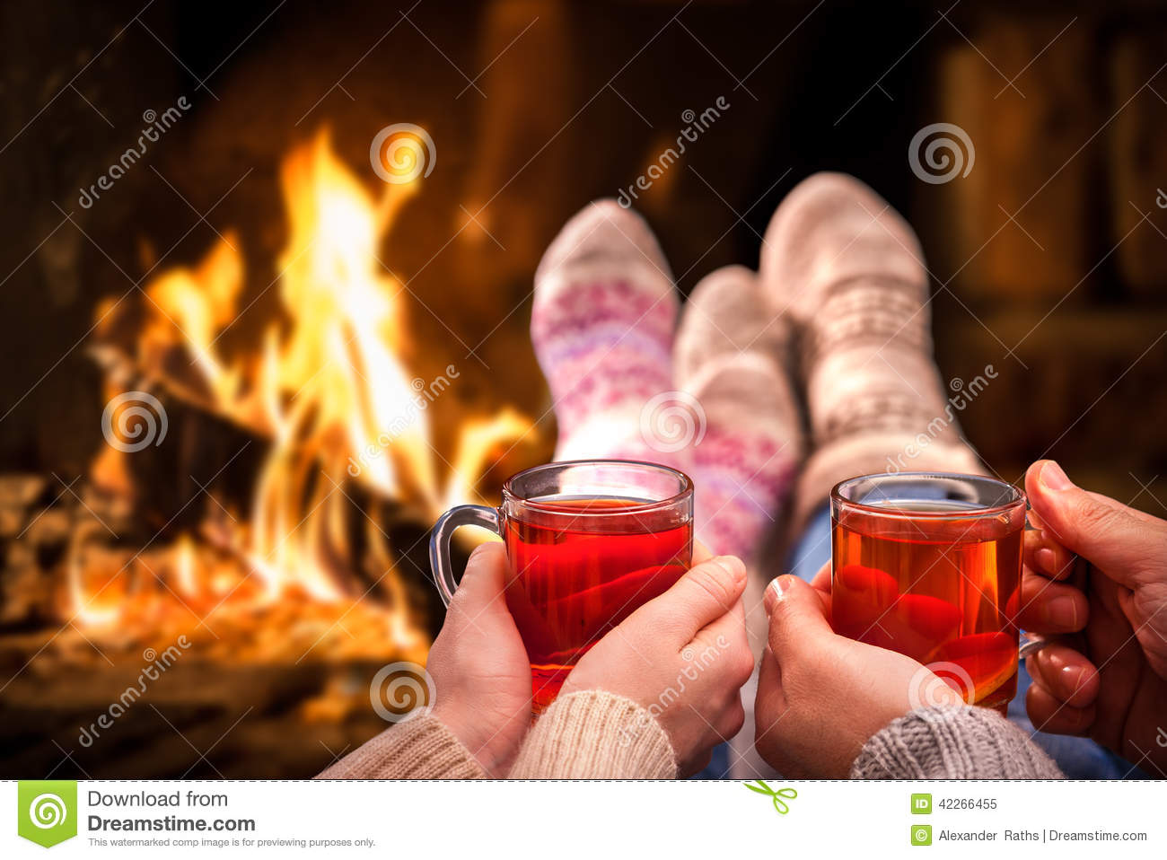 ... relaxing with mulled wine at romantic fireplace on winter evening