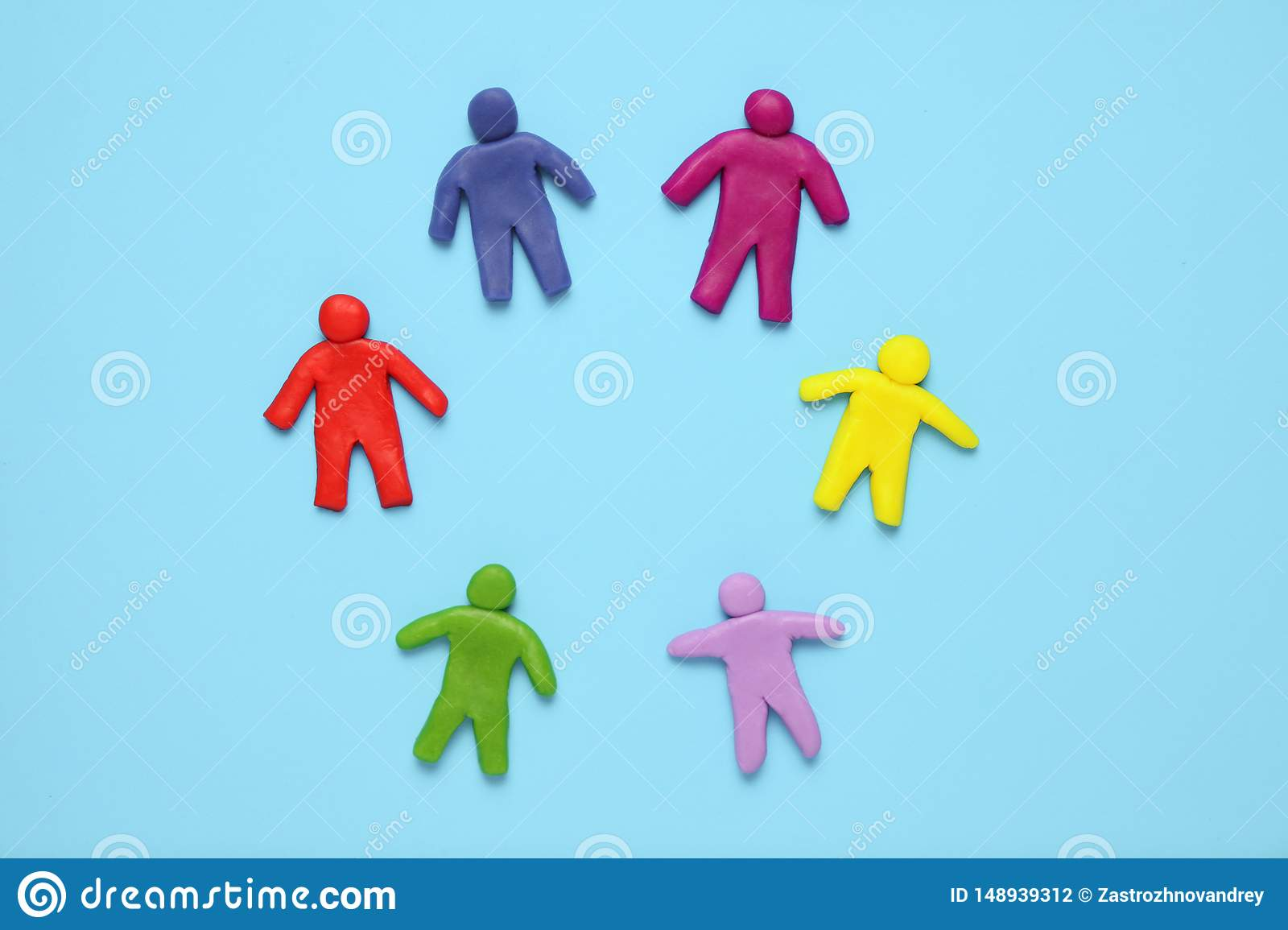 Multi сolored plasticine figures of people. Racial diversity and equality of people in world