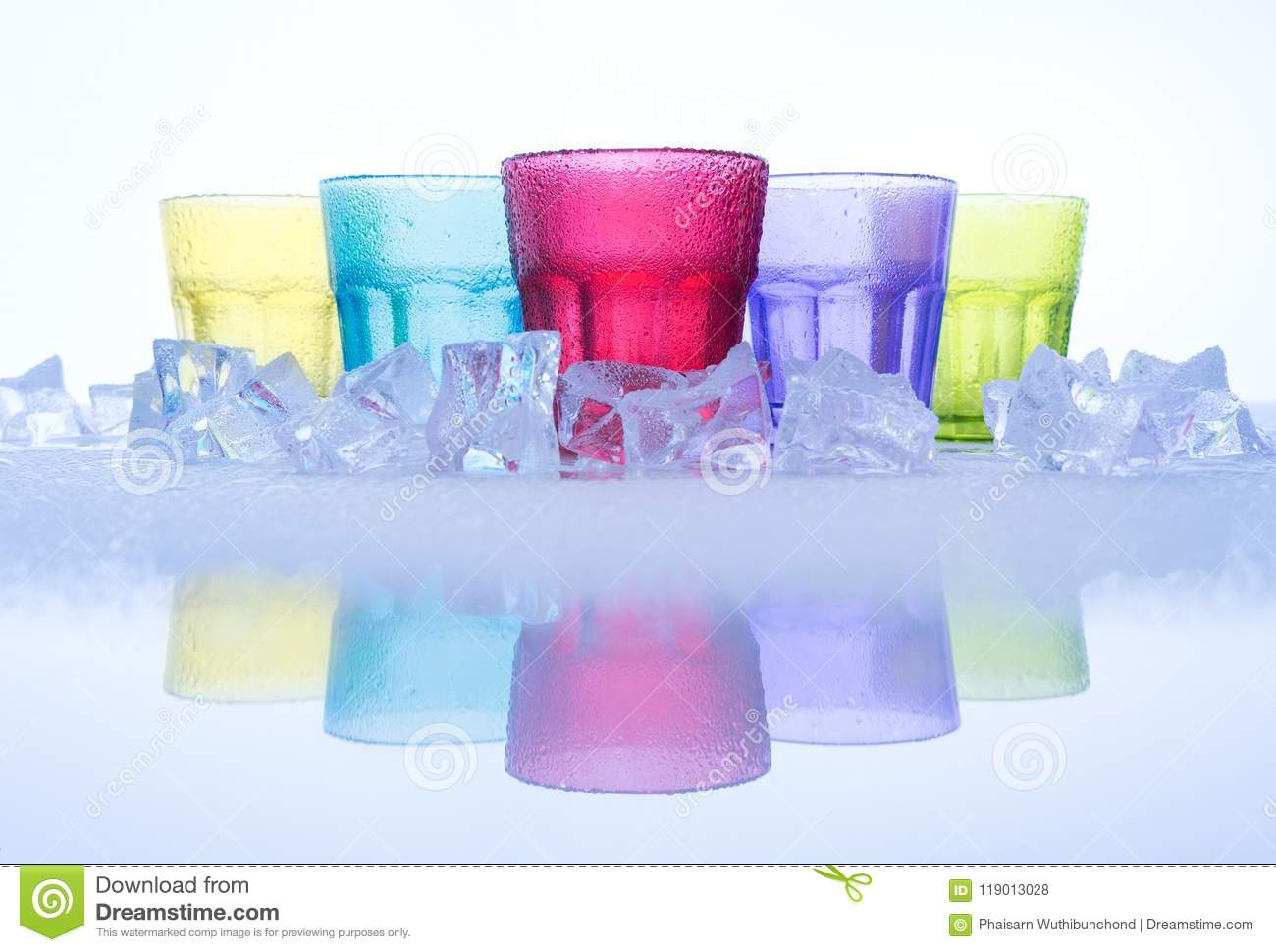 Multi Colored Of Cool Water Glasses With Cube Ices And Reflection